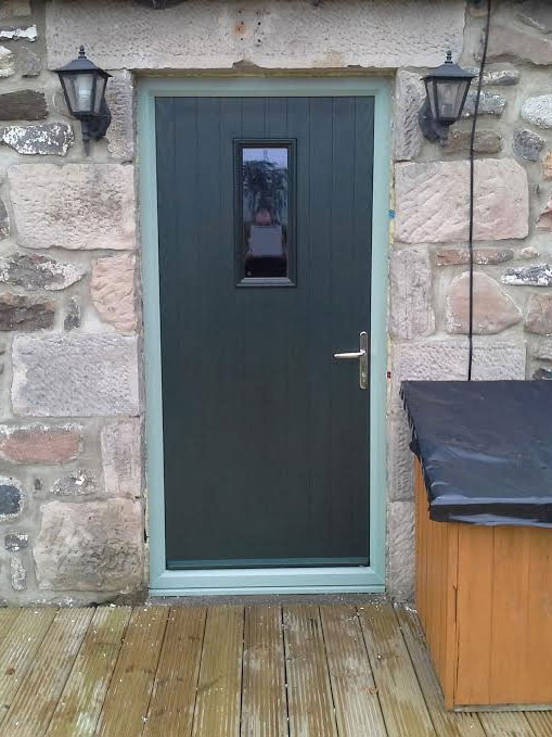 black composite front door with side panels