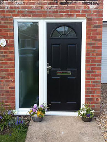 4 Panel Sunburst in Black & Side Light Composite Door